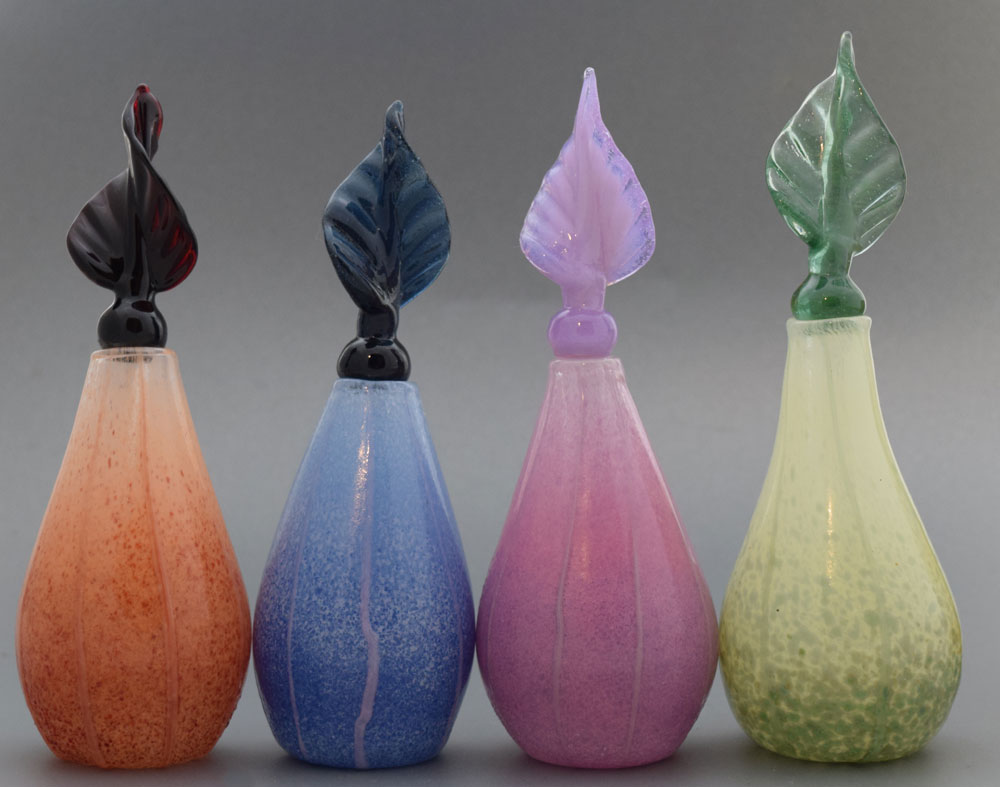 Hand blown glass bottles with twisted leaf stopper