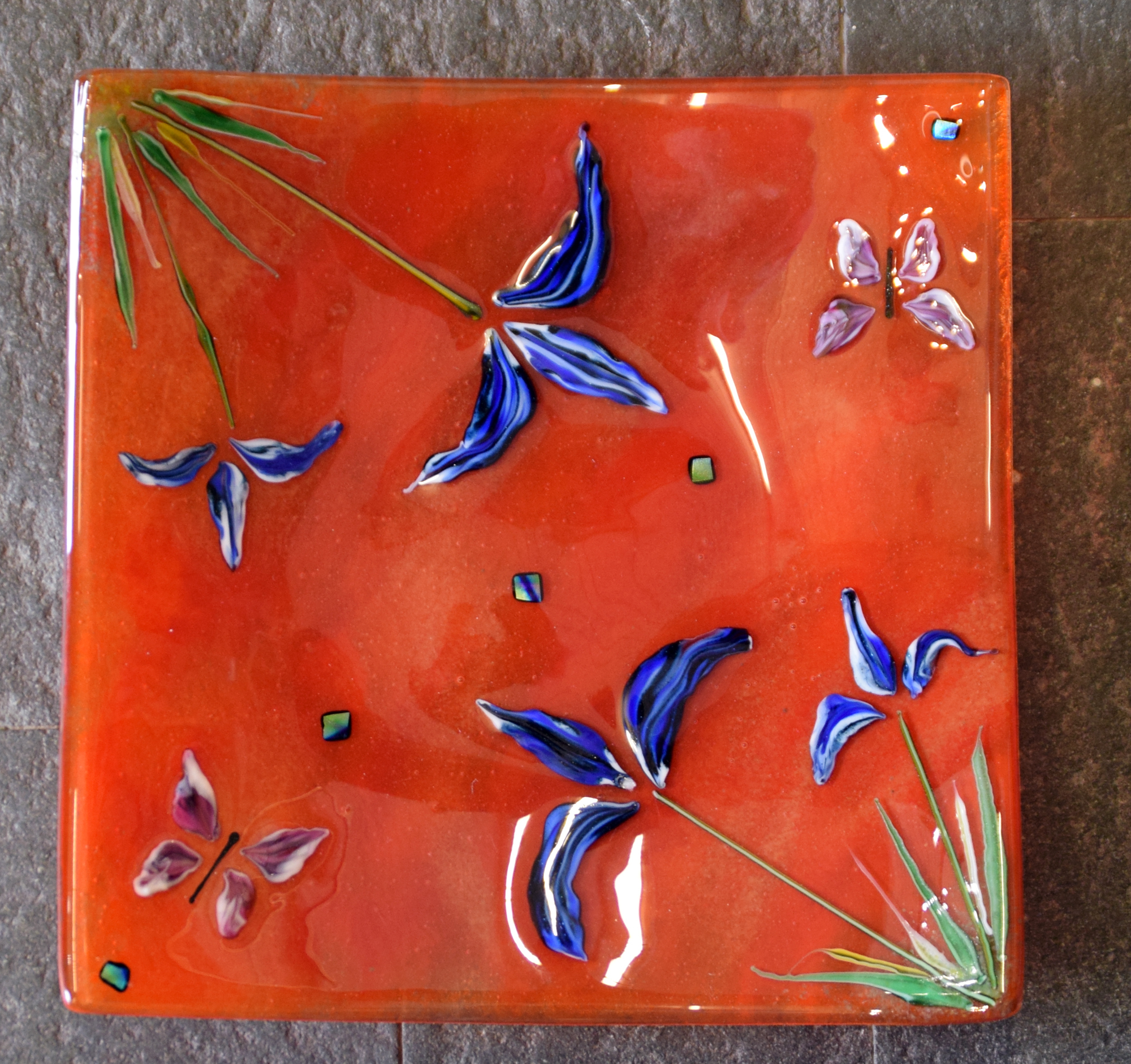 Fused glass plate in orange