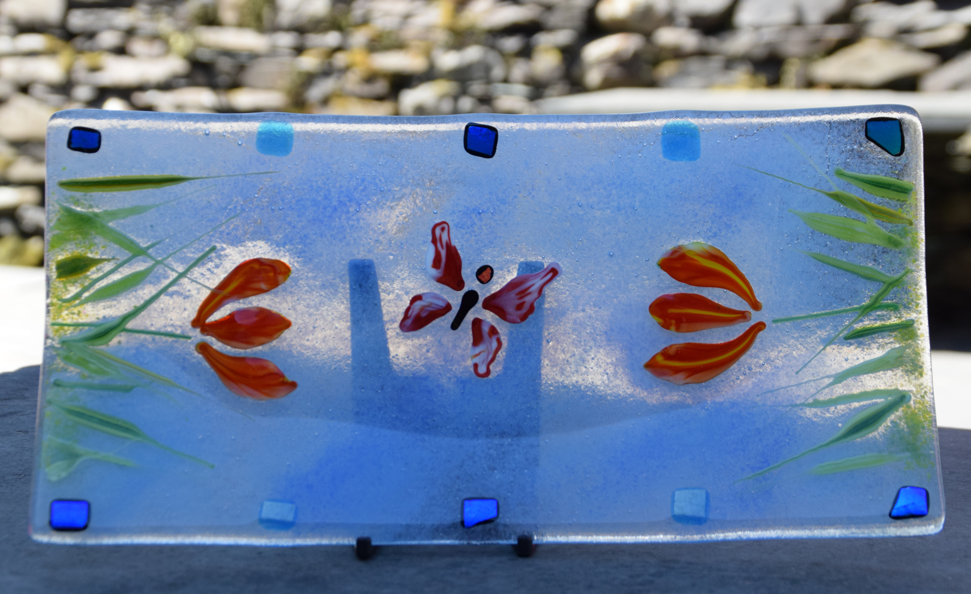 Blue platter with flowers and butterfly