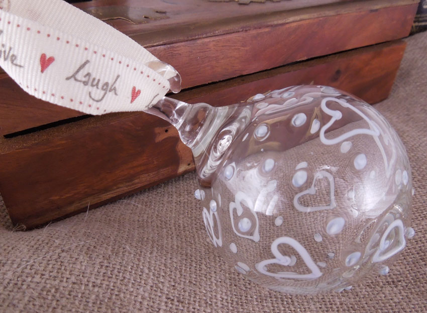 glass bauble with blue and white hearts and spots