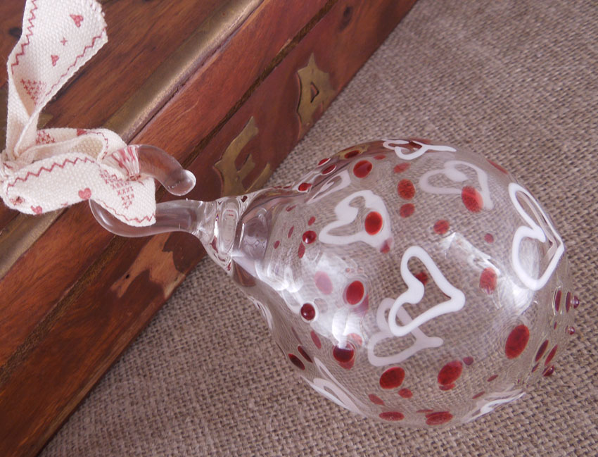 glass bauble with red dots and white hearts