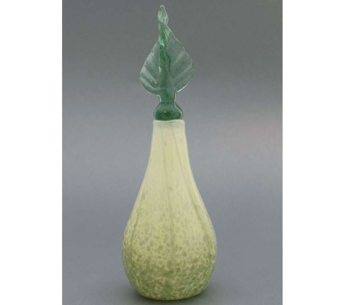 Green glass vase with twisted leaf stopper