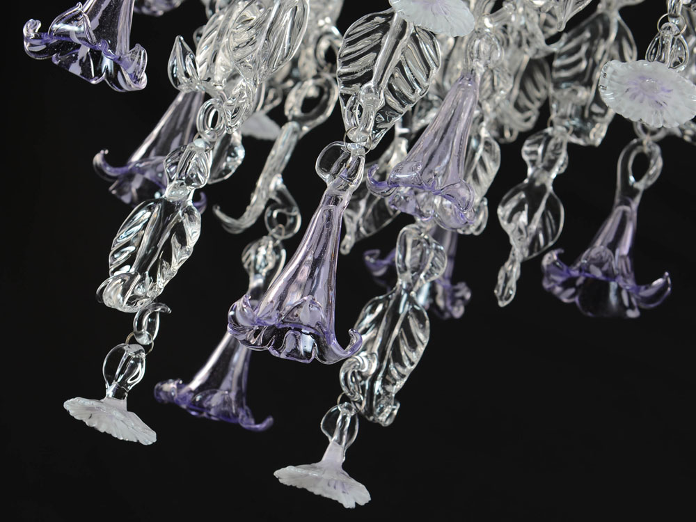 Glass chandelier with daisy and lily flowers