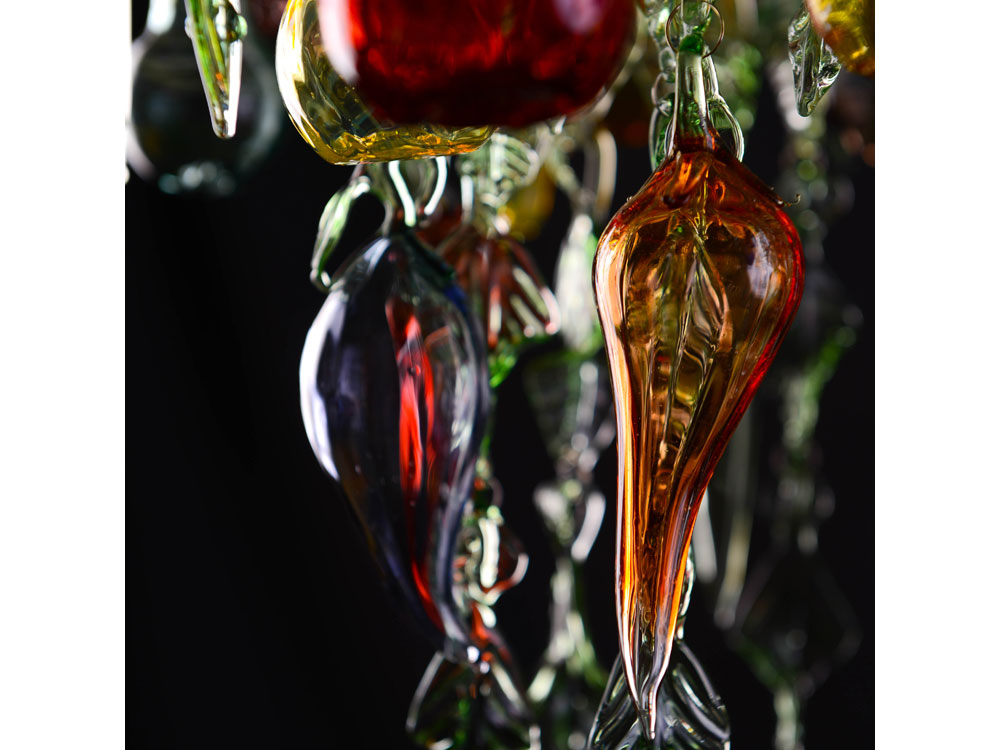 Glass chandelier with green leaves, blown fruit