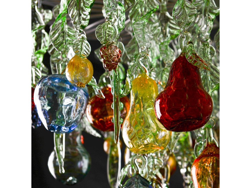 Glass chandelier with green leaves, blown fruit and berries