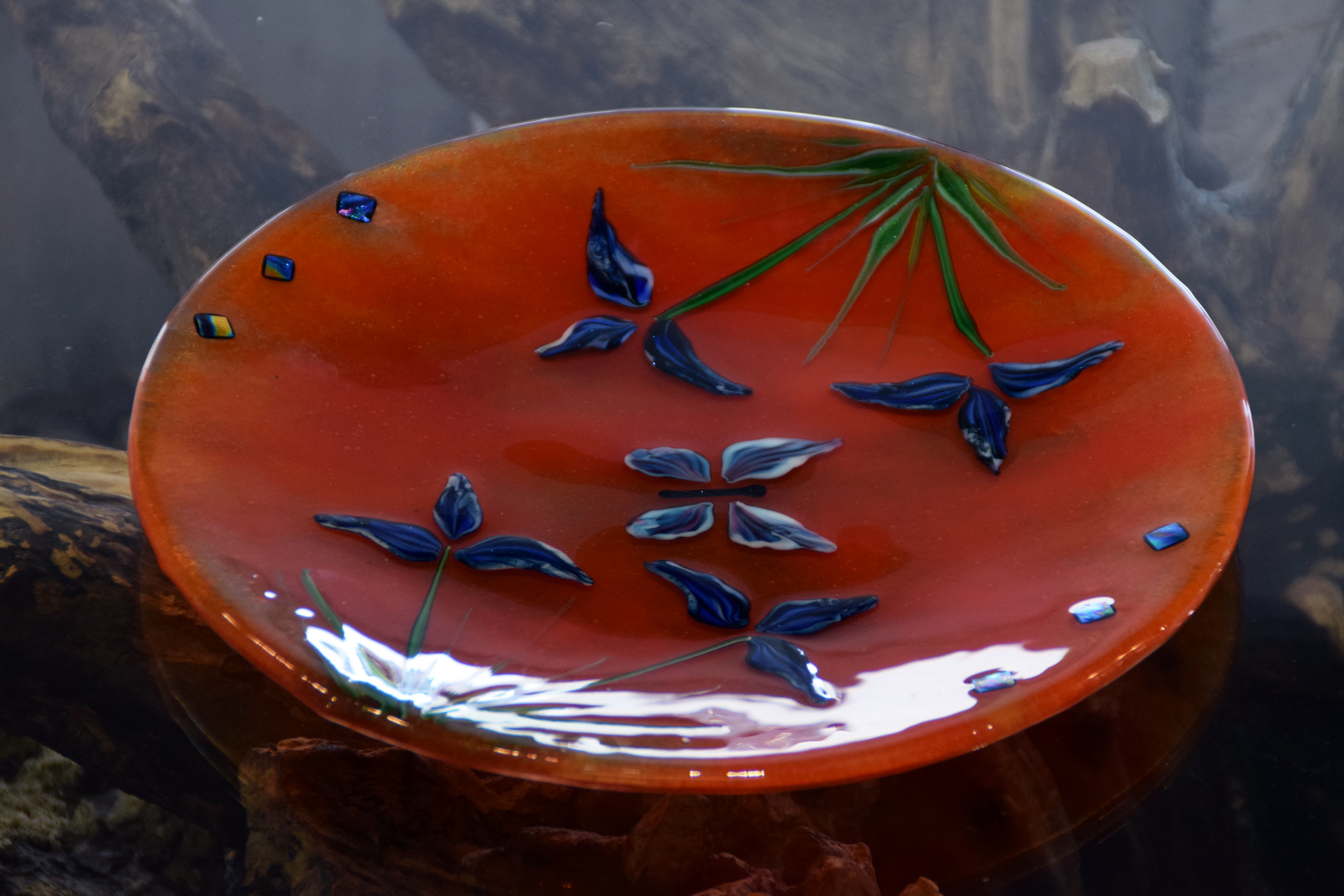 Orange glass bowl with iris and butterfly